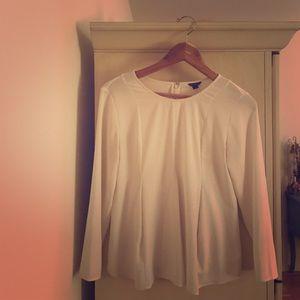 White blouse, flair at bottom